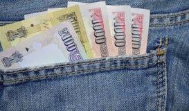 Blått färggrov bomullstvillfack med indiska pengar Fotografering för Bildbyråer