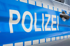 Blått för polisen för emblem för etikett för den tyskPolizei bilen försilvrar reflekterande Saf Arkivfoto