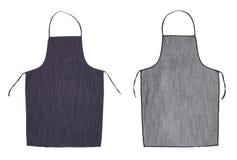 Blått förkläde för kök. Framdel- och baksidasikt arkivfoton