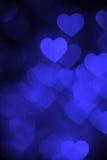 Blått foto för bakgrund för färghjärtabokeh Abstrakt ferie berömbakgrund royaltyfria foton