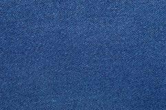 Blått grov bomullstvilltextur Tygtextur av jeansen Fotografering för Bildbyråer