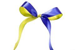 Blått-guling tygband och pilbåge bakgrund isolerad white Royaltyfria Foton