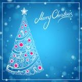 Blått julhälsningkort med att märka för hand dragen julgran och för glad jul Arkivfoto