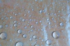 blått liten droppevatten för bakgrund royaltyfri bild