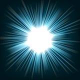 Blått ljust skina från mörkerbakgrund Arkivbild