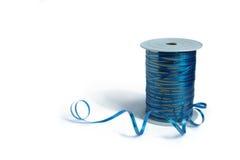 blått lockigt band Arkivbild