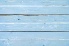 Blått målad bakgrund för tappningträplankatabell Arkivbild