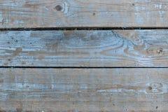Blått målad riden ut träplankaväggbakgrund detaljerad textur Arkivbilder