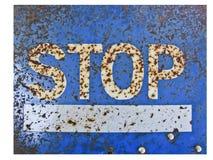 Blått metallstopptecken med rostad grunge fotografering för bildbyråer