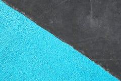 Blått och grå färger texturerade yttersida av asfalt för abstrakt bakgrund Arkivbild