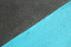 Blått och grå färger texturerade yttersida av asfalt för abstrakt bakgrund Arkivbilder