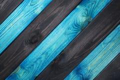 Blått och mörker - blå wood texturbakgrund arkivfoto