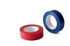 Blått och röda isolera bandrullar som isoleras på vit Arkivbild