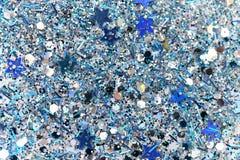 Blått och silver fryste mousserande stjärnor för snövinter blänker bakgrund Ferie jul, abstrakt begrepptextur för nytt år Arkivfoto