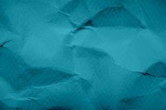 Blått- och tappningbakgrund vid skrynklig pappers- textur och fritt s royaltyfri bild