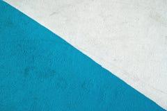 Blått och vit texturerad yttersida av asfalt för abstrakt bakgrund Arkivbilder
