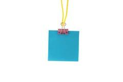 Blått pappers- hänga på ett rep Royaltyfria Foton