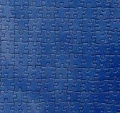 blått pussel Arkivbild