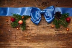 Blått satängband med pilbågen Royaltyfria Bilder