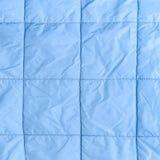 Blått silke vadderat tyg som en bakgrund Royaltyfria Bilder
