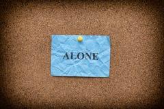 Blått skrynkligt papper med ordet som är ensamt på en kork, stiger ombord Royaltyfria Foton