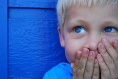 Blått synad pojke Royaltyfri Bild