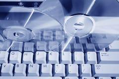 blått tonat disketttangentbord Arkivfoto