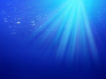 blått undervattens- för bakgrund Royaltyfria Bilder