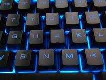 Blått upplyst panelljustangentbord Dator Keyboar arkivbilder