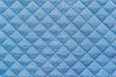 Blått vadderat syntetiskt tyg med grained textur Royaltyfria Foton