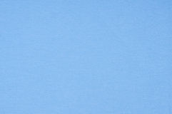 Blåttbakgrundstextilen, tyg texturerar. Arkivfoto