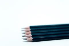 Blåttblyertspennor på vit bakgrund Fotografering för Bildbyråer