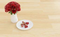 Blühen Sie im Vase mit Nachtisch auf einer Platte Stockfotografie