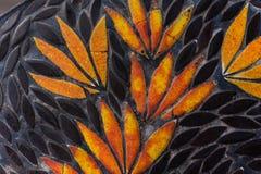 Blühen Sie Mosaikmuster mit schwarzer und orange Farbe Lizenzfreie Stockbilder