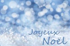 Blå Bokeh bakgrund, snö, Joyeux Noel Mean Merry Christmas Arkivfoto