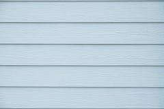 Blå wood texturbakgrund för tappning av husväggen Fotografering för Bildbyråer