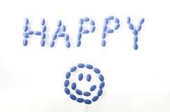 Blåa lyckliga preventivpillerar Arkivbild