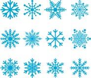 Blåa snöflingor Arkivfoton
