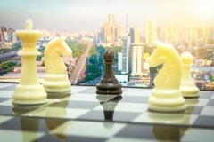Blach pawn in surrounded white team. Concept teamwprk business Stock Image