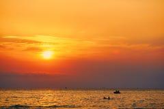 black över havssolnedgång Fotografering för Bildbyråer