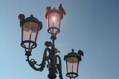 Black 3-light Post Lamp Under Blue Sky Stock Images