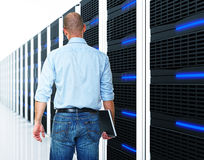 Black 3d server and man. Caucasian man and  datacentre with lots of server Stock Images