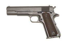 Black. 45 caliber pistol. 45 caliber pistol isolated over white Royalty Free Stock Photo