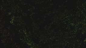 Black abstract fluorescent background with green sparkling lights and noise. Black abstract fluorescent background with green sparkling lights and phosphorescent royalty free stock image