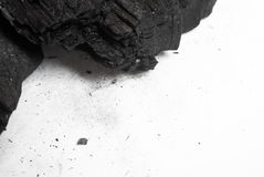 Black abstract textured composition on a white background. A selected focus close-up of a pile of cubes and powder of black mineral coal Stock Photos