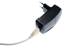Black AC-DC power supply adapter with USB connector. Stock Image
