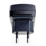 Black AC-DC power supply adapter with USB connector. Royalty Free Stock Photo