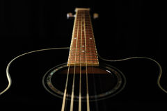 Black acoustic guitar Stock Photography