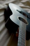 Black acoustic guitar. Top view of a black acoustic guitar royalty free stock photography