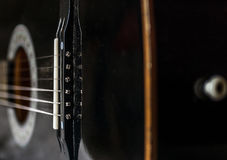 Black acoustic guitar back closeup Stock Photo
